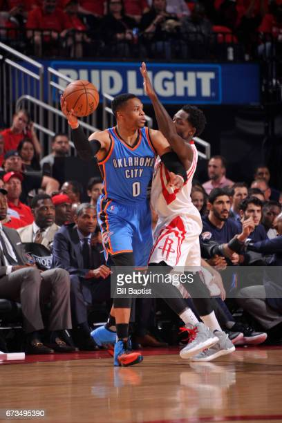 Russell Westbrook of the Oklahoma City Thunder looks to pass the ball while guarded by Patrick Beverley of the Houston Rockets in Game Five of the...