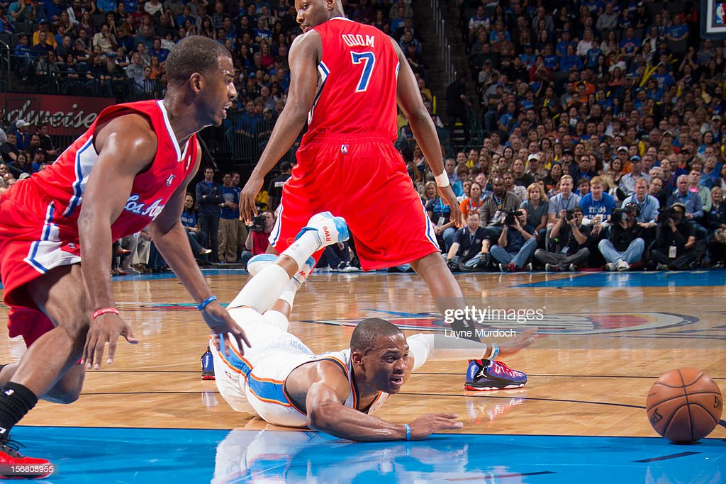Russell Westbrook #0 of the Oklahoma City Thunder loses control of the ball against Chris Paul #3 of the Los Angeles Clippers on November 21, 2012 at the Chesapeake Energy Arena in Oklahoma City, Oklahoma.