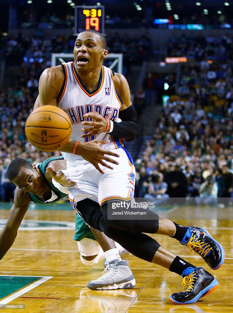 Russell Westbrook #0 of the Oklahoma City Thunder loses control of the ball after driving by Rajon Rondo #9 of the Boston Celtics during the game on November 23, 2012 at TD Garden in Boston, Massachusetts.