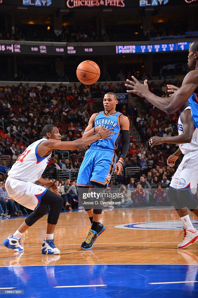 Russell Westbrook #0 of the Oklahoma City Thunder makes a pass against the Philadelphia 76ers at the Wells Fargo Center on November 24, 2012 in Philadelphia, Pennsylvania.