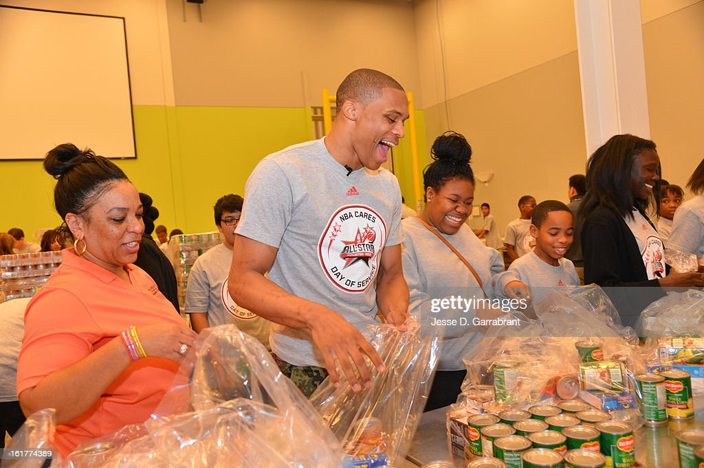 Russell Westbrook #0 of the Oklahoma City Thunder participates at the 2013 NBA Cares Day of Service at the Food Bank on February 15, 2013 in Houston, Texas.