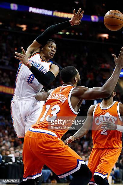 Russell Westbrook of the Oklahoma City Thunder passes around Tristan Thompson of the Cleveland Cavaliers at Quicken Loans Arena on January 29 2017 in...