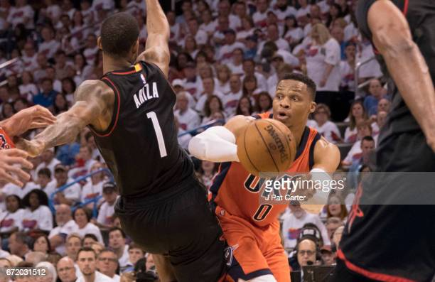 Russell Westbrook of the Oklahoma City Thunder passes the ball as Trevor Ariza of the Houston Rockets applies pressure during the second half of Game...