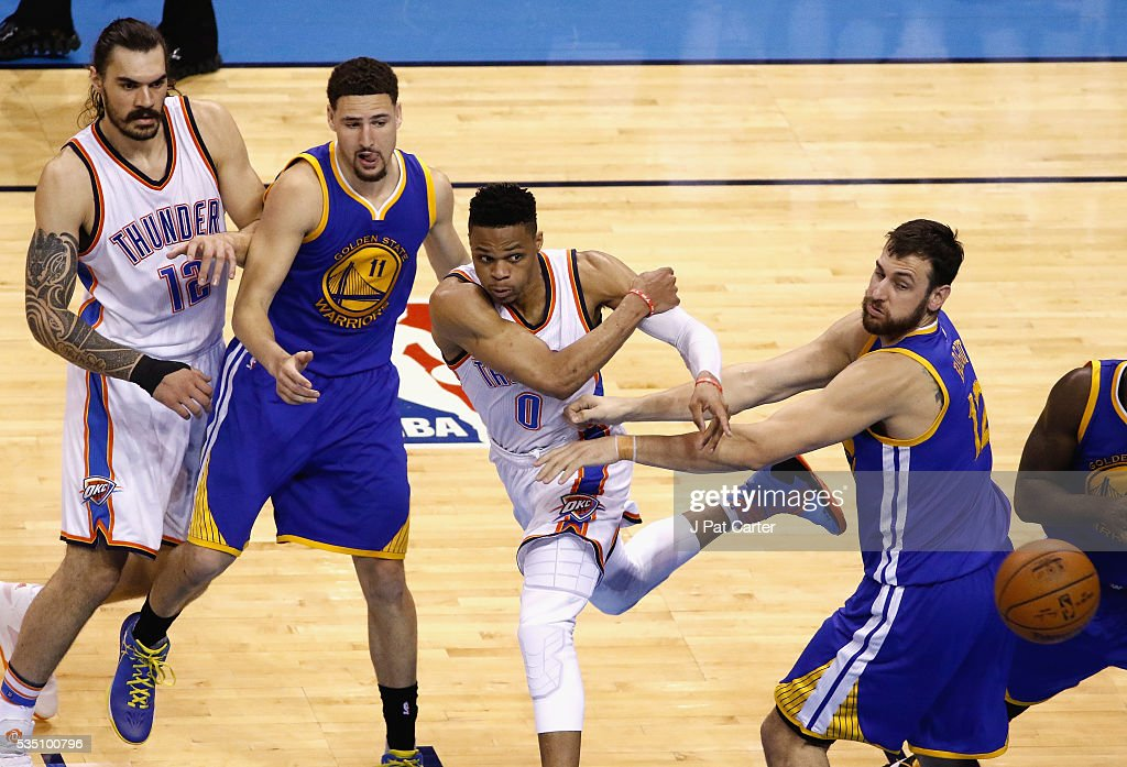 Russell Westbrook #0 of the Oklahoma City Thunder passes the ball during the second half against Klay Thompson #11 of the Golden State Warriors and Andrew Bogut #12 in game six of the Western Conference Finals during the 2016 NBA Playoffs at Chesapeake Energy Arena on May 28, 2016 in Oklahoma City, Oklahoma.