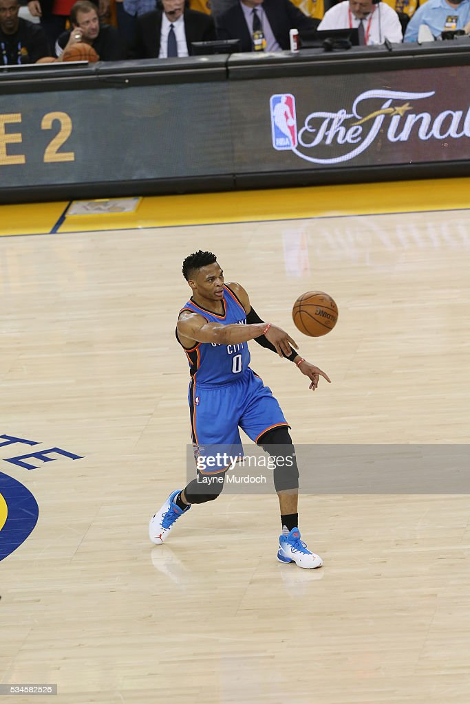 <a gi-track='captionPersonalityLinkClicked' href=/galleries/search?phrase=Russell+Westbrook&family=editorial&specificpeople=4044231 ng-click='$event.stopPropagation()'>Russell Westbrook</a> #0 of the Oklahoma City Thunder passes the ball against the Golden State Warriors in Game Five of the Western Conference Finals during the 2016 NBA Playoffs on May 26, 2016 at ORACLE Arena in Oakland, California.