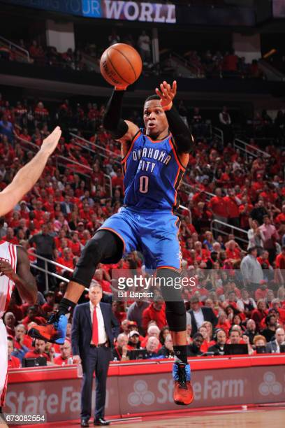 Russell Westbrook of the Oklahoma City Thunder passes the ball against the Houston Rockets in Game Five of the Western Conference Quarterfinals of...