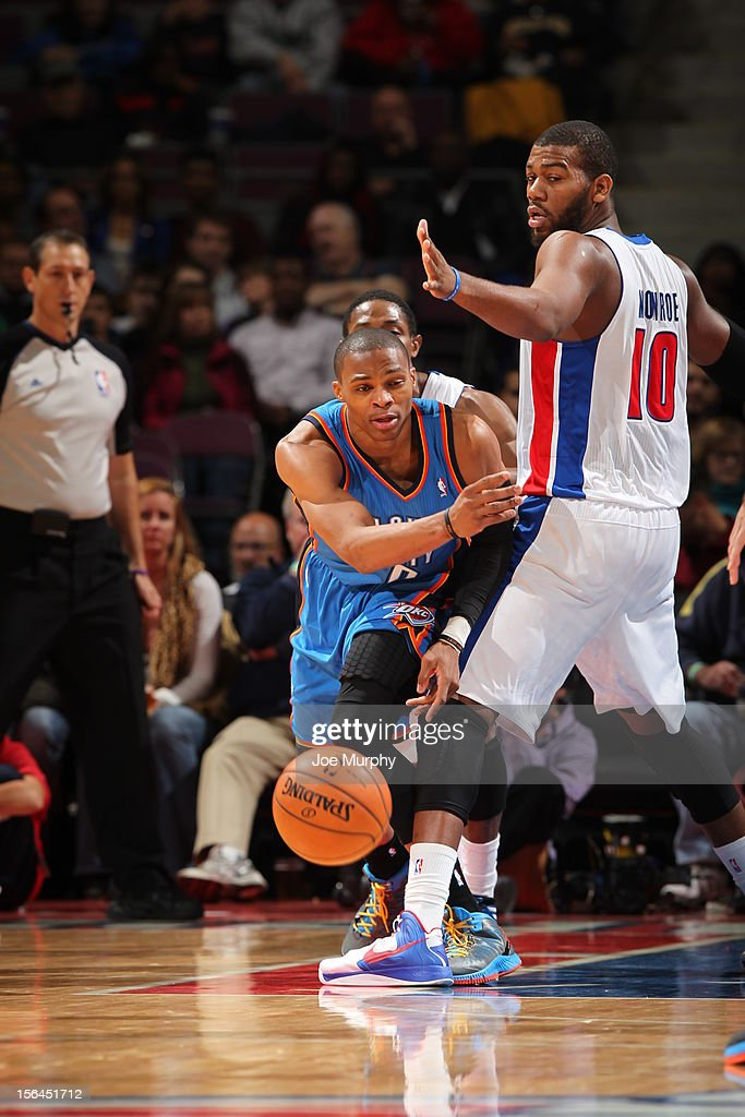 <a gi-track='captionPersonalityLinkClicked' href=/galleries/search?phrase=Russell+Westbrook&family=editorial&specificpeople=4044231 ng-click='$event.stopPropagation()'>Russell Westbrook</a> #0 of the Oklahoma City Thunder passes the ball while being defended by <a gi-track='captionPersonalityLinkClicked' href=/galleries/search?phrase=Greg+Monroe&family=editorial&specificpeople=5042440 ng-click='$event.stopPropagation()'>Greg Monroe</a> #10 of the Detroit Pistons on November 12, 2012 at The Palace of Auburn Hills in Auburn Hills, Michigan.
