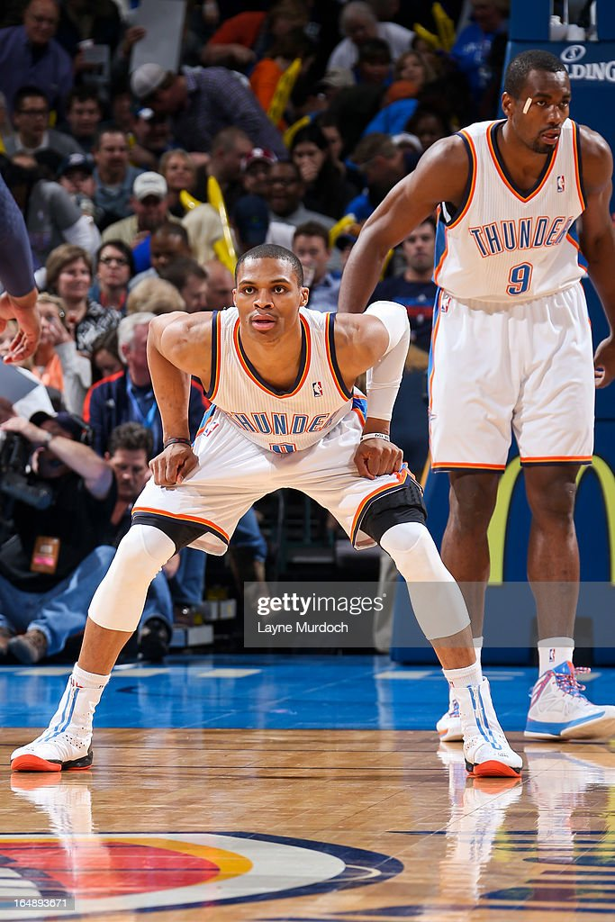 <a gi-track='captionPersonalityLinkClicked' href=/galleries/search?phrase=Russell+Westbrook&family=editorial&specificpeople=4044231 ng-click='$event.stopPropagation()'>Russell Westbrook</a> #0 of the Oklahoma City Thunder plays defense against the Washington Wizards on March 27, 2013 at the Chesapeake Energy Arena in Oklahoma City, Oklahoma.