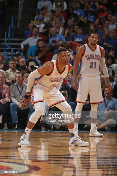Russell Westbrook of the Oklahoma City Thunder plays defense en route to the first ever perfect triple double in NBA history during the game against...