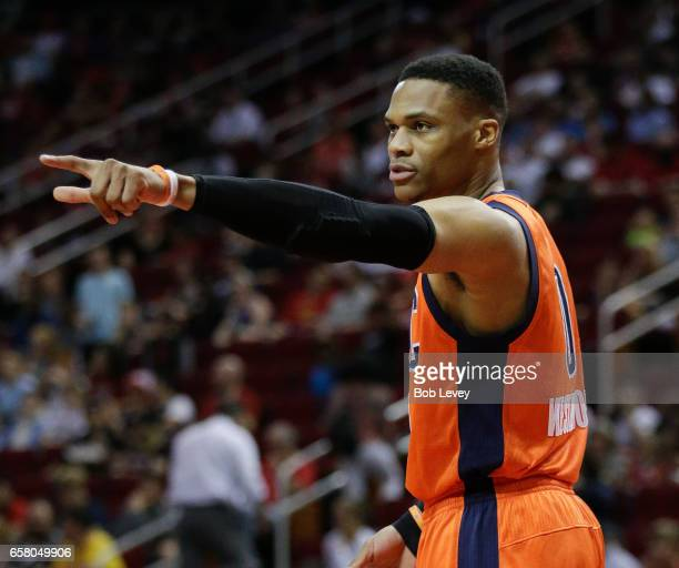Russell Westbrook of the Oklahoma City Thunder points over to the Houston Rockets bench at Toyota Center on March 26 2017 in Houston Texas NOTE TO...