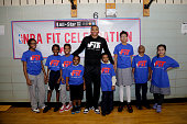 Russell Westbrook of the Oklahoma City Thunder poses for a photo with children as he participates in NBA Cares/FIT Day of Service at PS 181 Brooklyn...