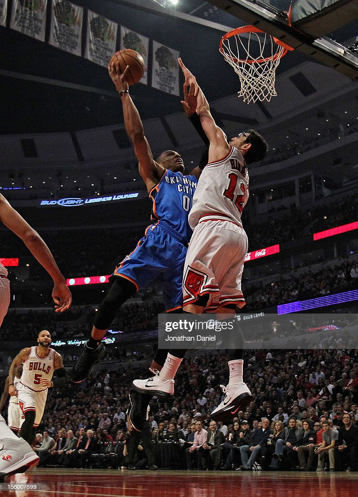 Russell Westbrook #0 of the Oklahoma City Thunder puts up a shot against Kirk Hinrich #12 of the Chicago Bulls at the United Center on November 8, 2012 in Chicago, Illinois.The Thunder defeated the Bulls 97-91.