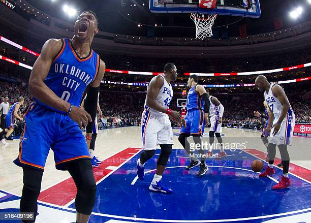 Russell Westbrook of the Oklahoma City Thunder reacts after a dunk against Elton Brand and Carl Landry of the Philadelphia 76ers on March 18 2016 at...