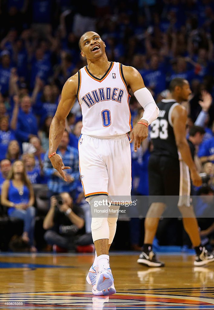 <a gi-track='captionPersonalityLinkClicked' href=/galleries/search?phrase=Russell+Westbrook&family=editorial&specificpeople=4044231 ng-click='$event.stopPropagation()'>Russell Westbrook</a> #0 of the Oklahoma City Thunder reacts after making a three point basket late in the first half against the San Antonio Spurs during Game Three of the Western Conference Finals of the 2014 NBA Playoffs at Chesapeake Energy Arena on May 25, 2014 in Oklahoma City, Oklahoma.