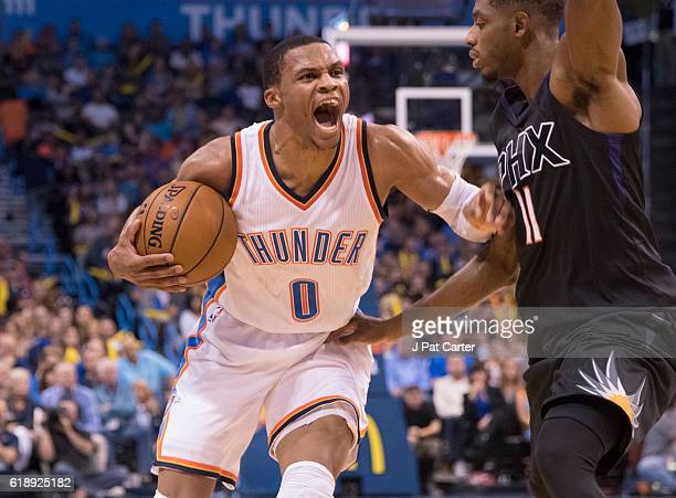 Russell Westbrook of the Oklahoma City Thunder reacts as Brandon Knight of the Phoenix Suns applies pressure during the second half of a NBA game at...
