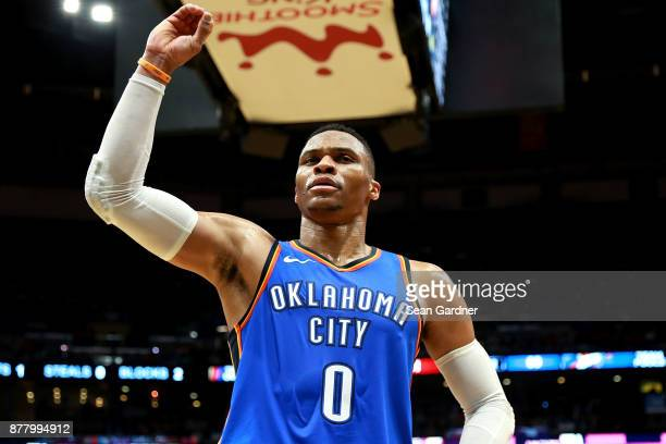 Russell Westbrook of the Oklahoma City Thunder reacts to a fan during a NBA game against the New Orleans Pelicans at the Smoothie King Center on...
