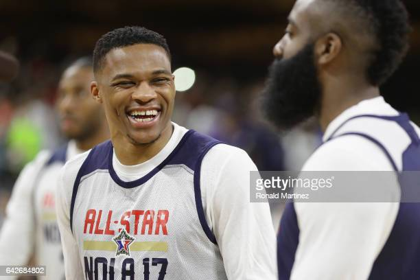 Russell Westbrook of the Oklahoma City Thunder reacts with James Harden of the Houston Rockets during practice for the 2017 NBA AllStar Game at the...