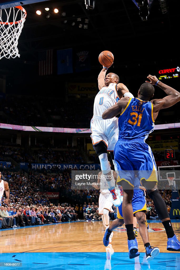 Russell Westbrook #0 of the Oklahoma City Thunder rises for a dunk against Festus Ezeli #31 of the Golden State Warriors on February 6, 2013 at the Chesapeake Energy Arena in Oklahoma City, Oklahoma.