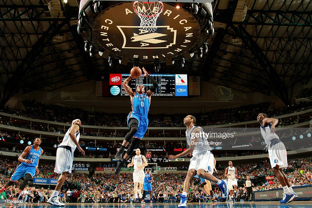 Russell Westbrook #0 of the Oklahoma City Thunder rises for a dunk against Brandan Wright #34 of the Dallas Mavericks on March 17, 2013 at the American Airlines Center in Dallas, Texas.