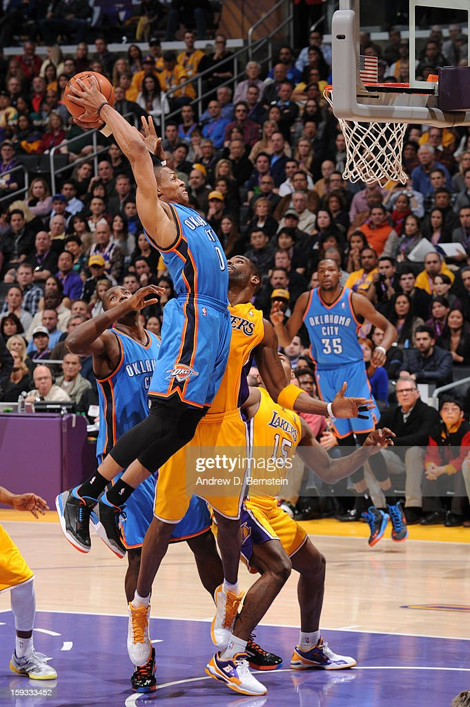 Russell Westbrook #0 of the Oklahoma City Thunder rises for a dunk against the Los Angeles Lakers at Staples Center on January 11, 2013 in Los Angeles, California.