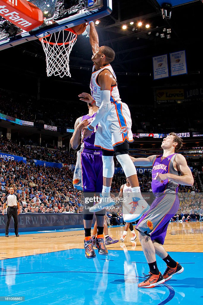 Russell Westbrook #0 of the Oklahoma City Thunder rises for a dunk against the Phoenix Suns on February 8, 2013 at the Chesapeake Energy Arena in Oklahoma City, Oklahoma.