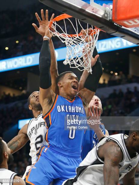 Russell Westbrook of the Oklahoma City Thunder screams while trying to dunk over the San Antonio Spurs at ATT Center on January 31 2017 in San...