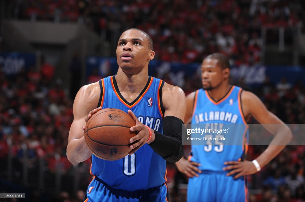 <a gi-track='captionPersonalityLinkClicked' href=/galleries/search?phrase=Russell+Westbrook&family=editorial&specificpeople=4044231 ng-click='$event.stopPropagation()'>Russell Westbrook</a> #0 of the Oklahoma City Thunder shoots a free throw in Game Three of the Western Conference Semifinals against the Los Angeles Clippers during the 2014 NBA Playoffs at Staples Center on May 9, 2014 in Los Angeles, California.