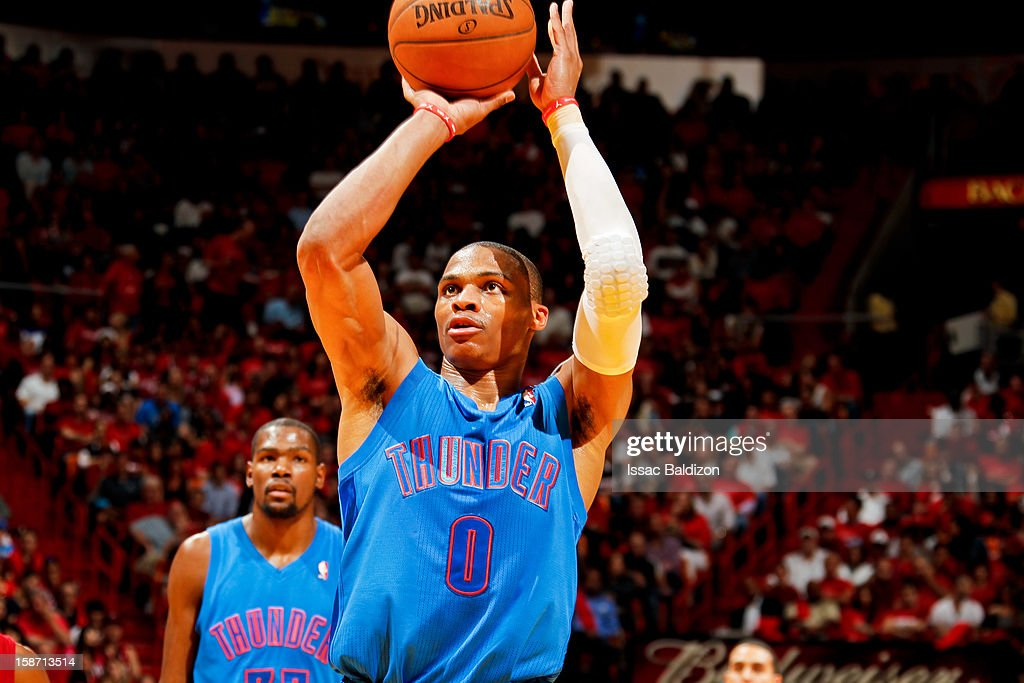 Russell Westbrook #0 of the Oklahoma City Thunder shoots a free-throw as teammate Kevin Durant #35 looks on against the Miami Heat during a Christmas Day game on December 25, 2012 at American Airlines Arena in Miami, Florida.