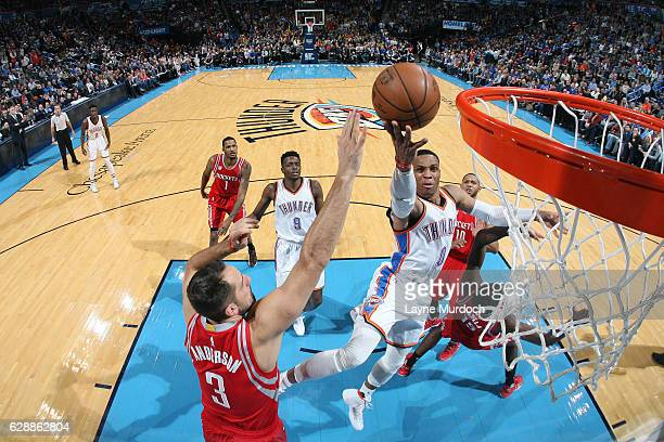 Russell Westbrook of the Oklahoma City Thunder shoots a lay up against the Houston Rockets on December 9 2016 at Chesapeake Energy Arena in Oklahoma...