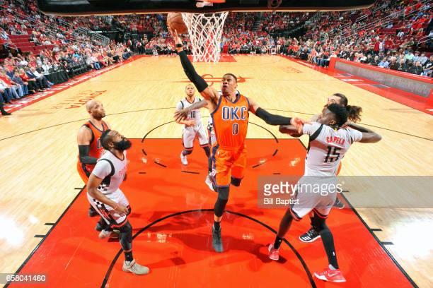 Russell Westbrook of the Oklahoma City Thunder shoots a lay up against the Houston Rockets during the game on March 26 2017 at the Toyota Center in...