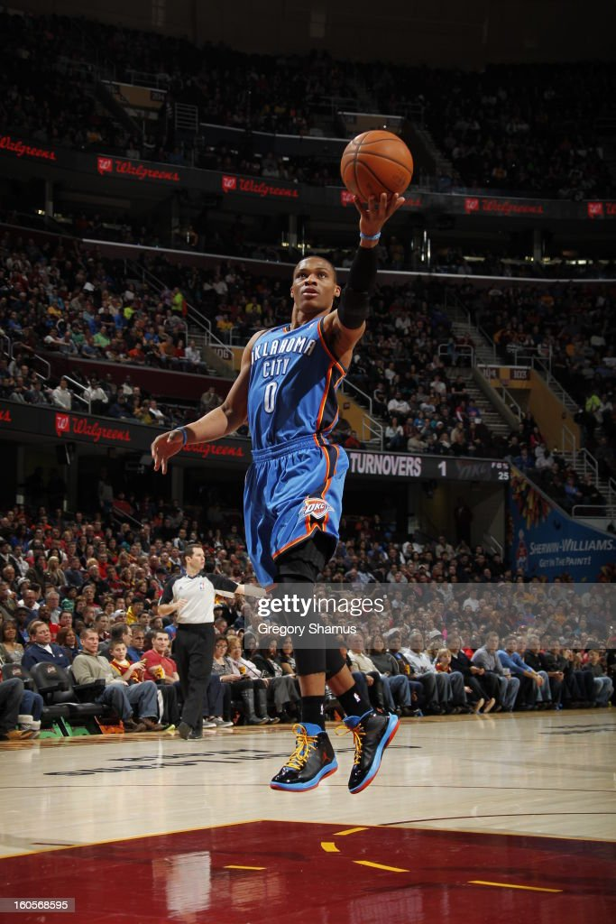 Russell Westbrook #0 of the Oklahoma City Thunder shoots a layup against the Cleveland Cavaliers at The Quicken Loans Arena on February 2, 2013 in Cleveland, Ohio.