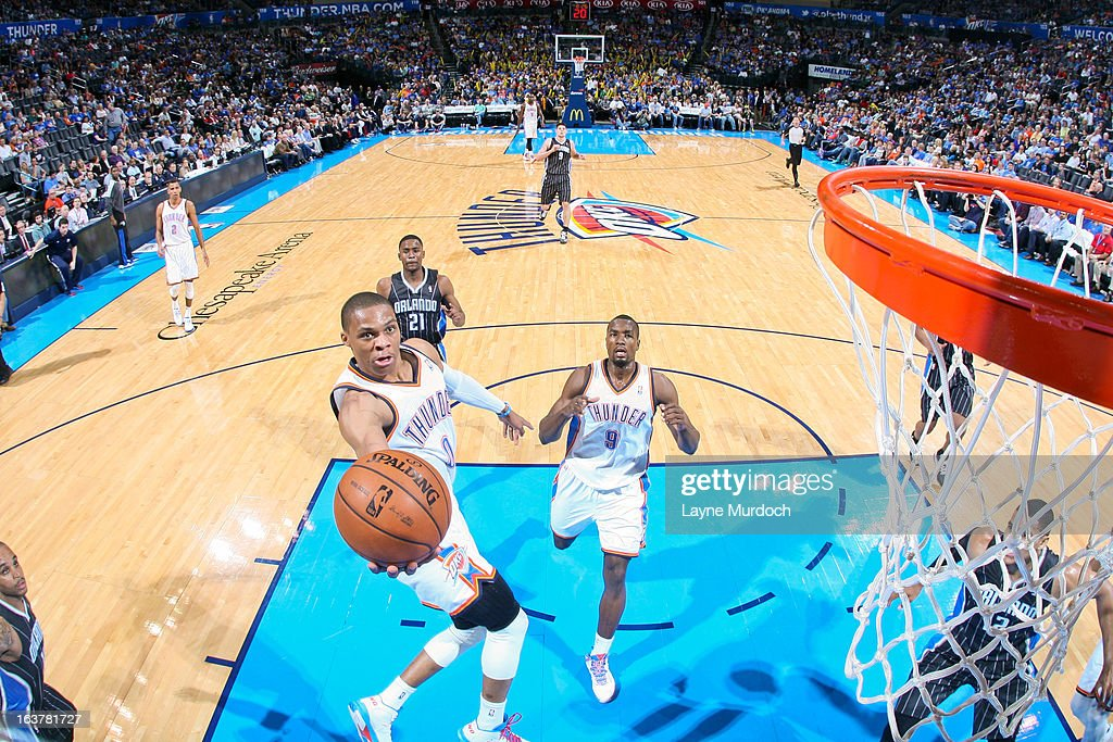 <a gi-track='captionPersonalityLinkClicked' href=/galleries/search?phrase=Russell+Westbrook&family=editorial&specificpeople=4044231 ng-click='$event.stopPropagation()'>Russell Westbrook</a> #0 of the Oklahoma City Thunder shoots a layup against the Orlando Magic on March 15, 2013 at the Chesapeake Energy Arena in Oklahoma City, Oklahoma.