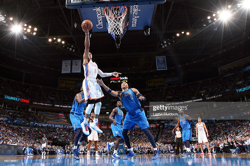 <a gi-track='captionPersonalityLinkClicked' href=/galleries/search?phrase=Russell+Westbrook&family=editorial&specificpeople=4044231 ng-click='$event.stopPropagation()'>Russell Westbrook</a> #0 of the Oklahoma City Thunder shoots a layup againsy <a gi-track='captionPersonalityLinkClicked' href=/galleries/search?phrase=Shawn+Marion&family=editorial&specificpeople=201566 ng-click='$event.stopPropagation()'>Shawn Marion</a> #0 of the Dallas Mavericks on February 4, 2013 at the Chesapeake Energy Arena in Oklahoma City, Oklahoma.