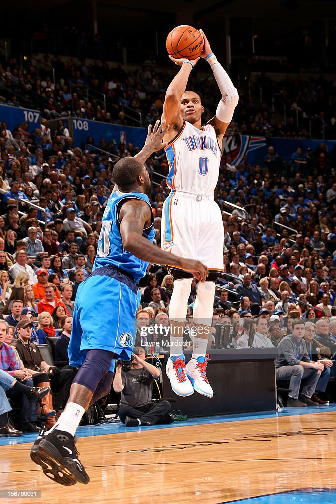 Russell Westbrook #0 of the Oklahoma City Thunder shoots a three-pointer against the Dallas Mavericks on December 27, 2012 at the Chesapeake Energy Arena in Oklahoma City, Oklahoma.