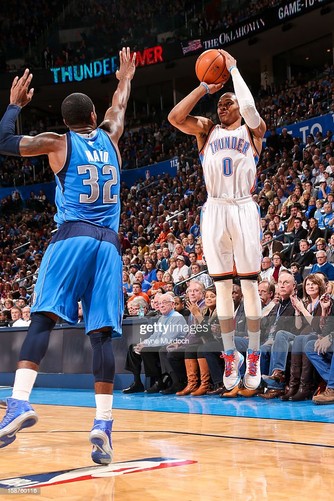 Russell Westbrook #0 of the Oklahoma City Thunder shoots a three-pointer against O.J. Mayo #32 of the Dallas Mavericks on December 27, 2012 at the Chesapeake Energy Arena in Oklahoma City, Oklahoma.