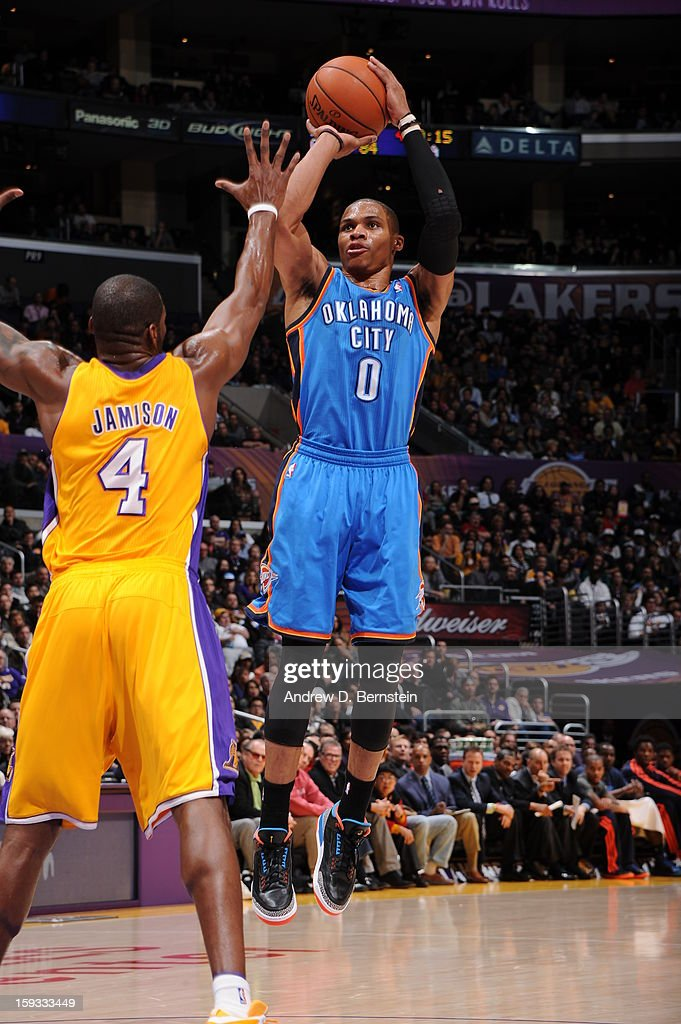 Russell Westbrook #0 of the Oklahoma City Thunder shoots against Antawn Jamison #4 of the Los Angeles Lakers at Staples Center on January 11, 2013 in Los Angeles, California.