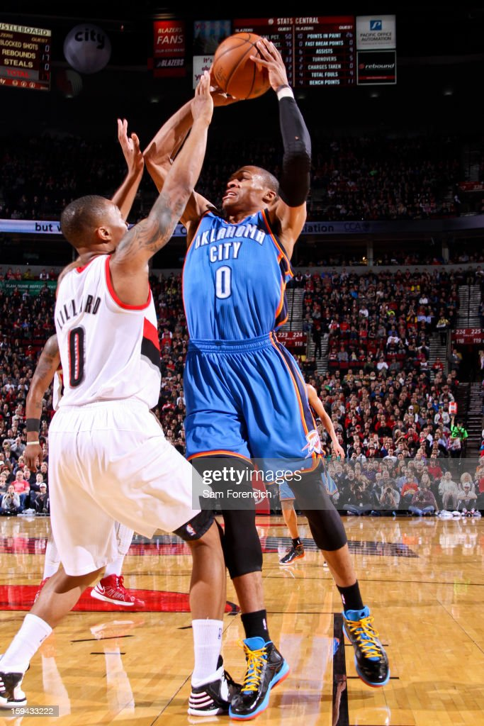 Russell Westbrook #0 of the Oklahoma City Thunder shoots against Damian Lillard #0 of the Portland Trail Blazers on January 13, 2013 at the Rose Garden Arena in Portland, Oregon.
