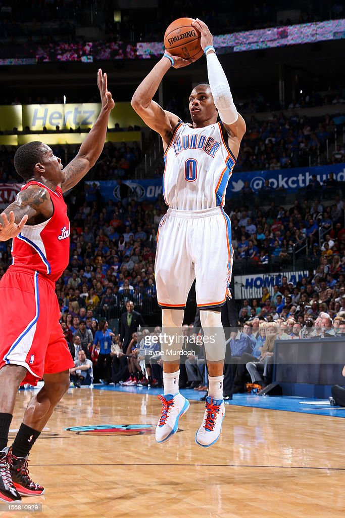 Russell Westbrook #0 of the Oklahoma City Thunder shoots against Eric Bledsoe #12 of the Los Angeles Clippers on November 21, 2012 at the Chesapeake Energy Arena in Oklahoma City, Oklahoma.