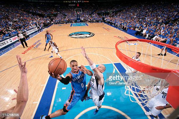 Russell Westbrook of the Oklahoma City Thunder shoots against Jason Kidd the Dallas Mavericks during Game Five of the Western Conference Finals in...