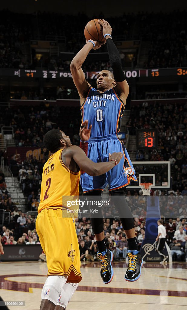 Russell Westbrook #0 of the Oklahoma City Thunder shoots against Kyrie Irving #2 of the Cleveland Cavaliers at The Quicken Loans Arena on February 2, 2013 in Cleveland, Ohio.