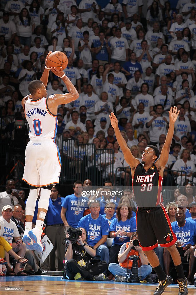 <a gi-track='captionPersonalityLinkClicked' href=/galleries/search?phrase=Russell+Westbrook&family=editorial&specificpeople=4044231 ng-click='$event.stopPropagation()'>Russell Westbrook</a> #0 of the Oklahoma City Thunder shoots against <a gi-track='captionPersonalityLinkClicked' href=/galleries/search?phrase=Norris+Cole&family=editorial&specificpeople=5770147 ng-click='$event.stopPropagation()'>Norris Cole</a> #30 of the Miami Heat during Game Two of the 2012 NBA Finals at Chesapeake Energy Arena on June 14, 2012 in Oklahoma City, Oklahoma.