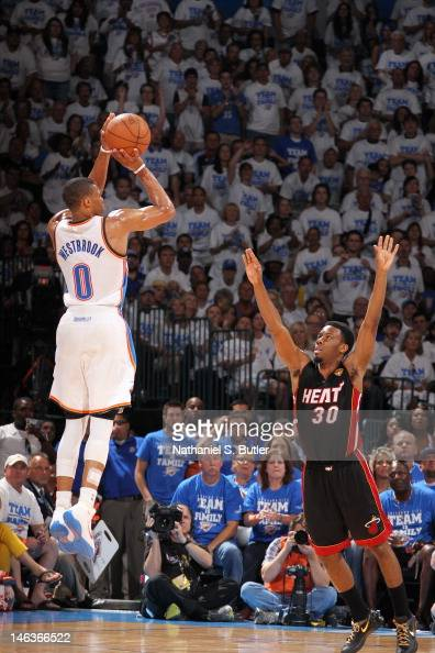 Russell Westbrook of the Oklahoma City Thunder shoots against Norris Cole of the Miami Heat during Game Two of the 2012 NBA Finals at Chesapeake...
