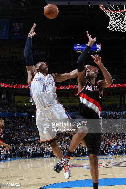 Russell Westbrook of the Oklahoma City Thunder shoots against LaMarcus Aldridge of the Portland Trail Blazers on March 27 2011 at the Oklahoma City...