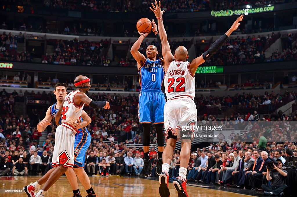 Russell Westbrook #0 of the Oklahoma City Thunder shoots against Taj Gibson #22 of the Chicago Bulls on November 8, 2012 at the United Center in Chicago, Illinois.