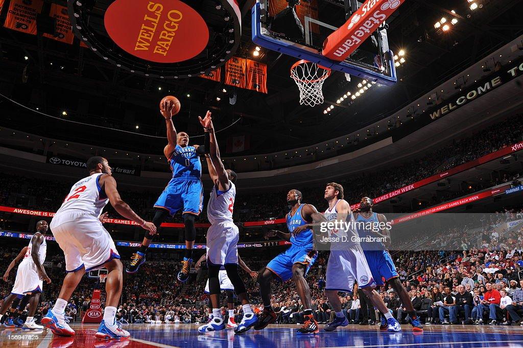 Russell Westbrook #0 of the Oklahoma City Thunder shoots against the Philadelphia 76ersat the Wells Fargo Center on November 24, 2012 in Philadelphia, Pennsylvania.
