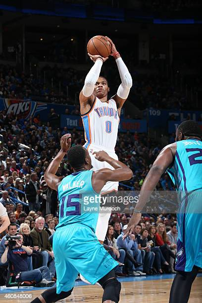 Russell Westbrook of the Oklahoma City Thunder shoots against the Charlotte Hornetsduring the game on December 26 2014 at Chesapeake Energy Arena in...