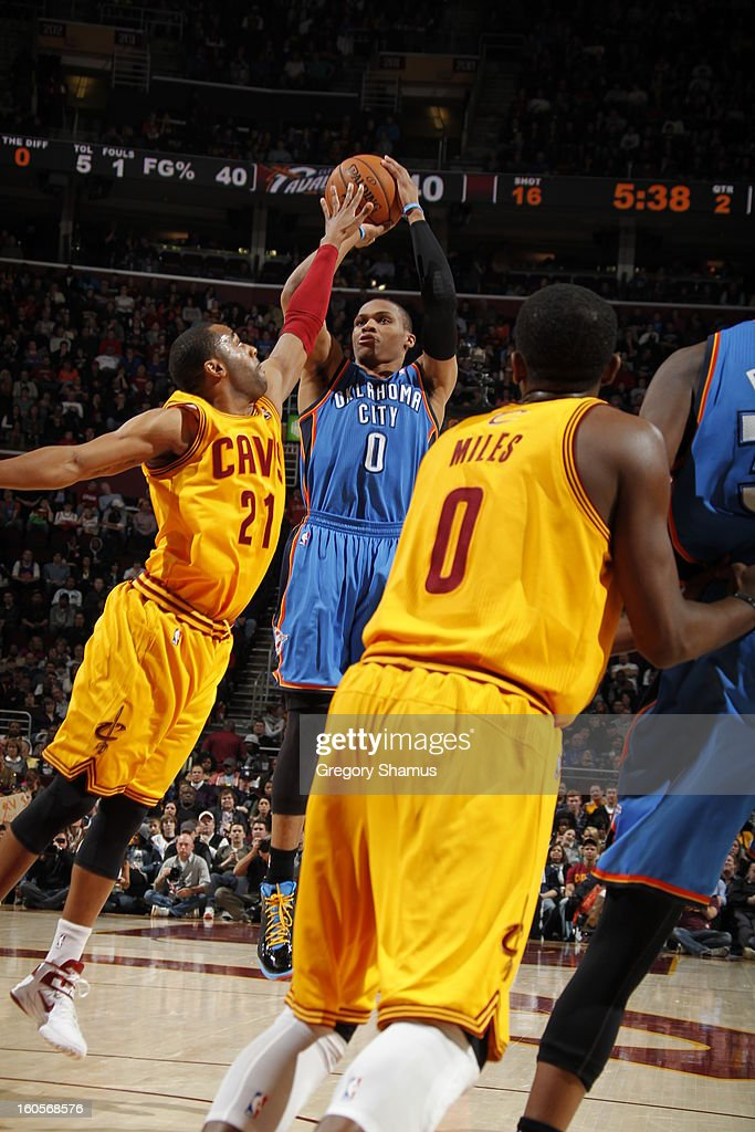 Russell Westbrook #0 of the Oklahoma City Thunder shoots against Wayne Ellington #21 of the Cleveland Cavaliers at The Quicken Loans Arena on February 2, 2013 in Cleveland, Ohio.