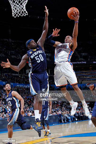 Russell Westbrook of the Oklahoma City Thunder shoots against Zach Randolph of the Memphis Grizzlies on February 8 2011 at the Oklahoma City Arena in...
