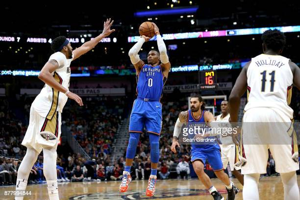 Russell Westbrook of the Oklahoma City Thunder shoots over Anthony Davis during a NBA game at the Smoothie King Center on November 20 2017 in New...