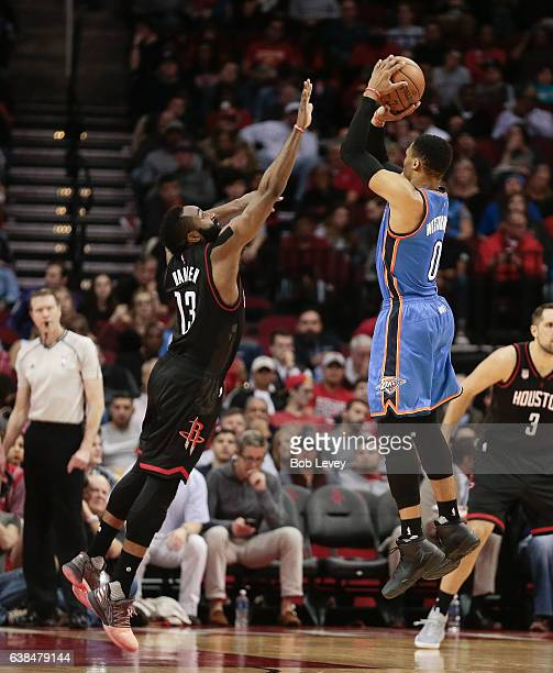 Russell Westbrook of the Oklahoma City Thunder shoots over James Harden of the Houston Rockets at Toyota Center on January 5 2017 in Houston Texas...